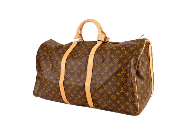 A large Louis Vuitton brown and tan leather monogram hold-all