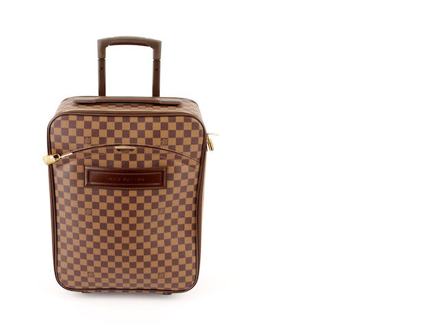A small Louis Vuitton damier rolling suitcase