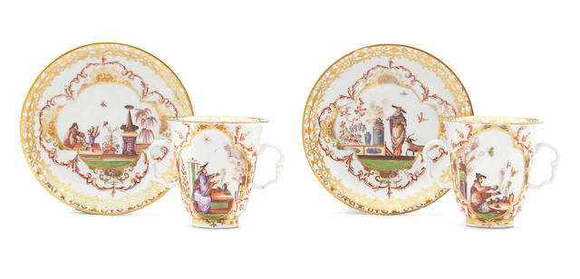 Two Meissen double-handled beakers and associated saucers, circa 1725