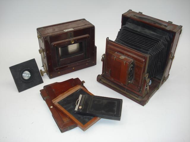 A small collection of wooden field cameras and accessories: