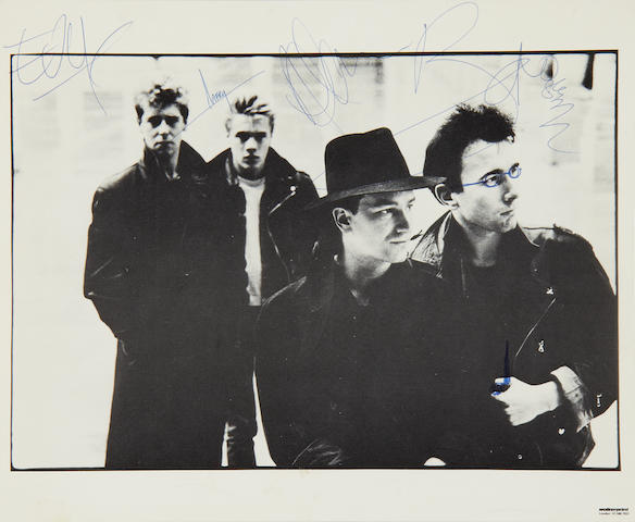 U2: An autographed photograph of U2 and memorabilia, 1980s,