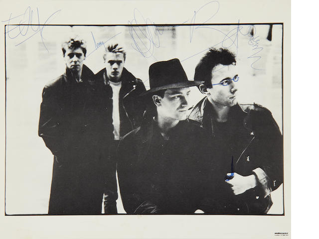 U2: An autographed photograph of U2 and other items, 1980s,