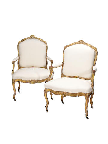 A pair of Louis XV carved giltwood armchairs by Tilliard