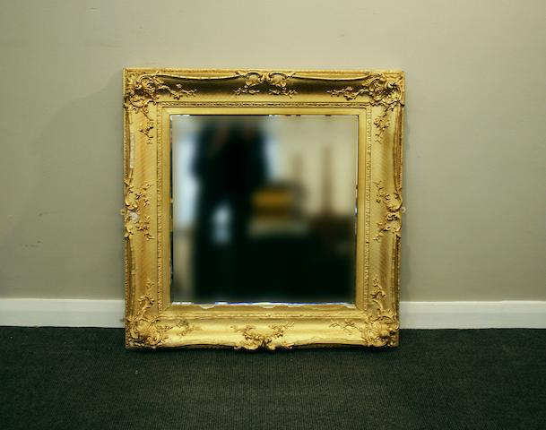 A group of four wall mirrors