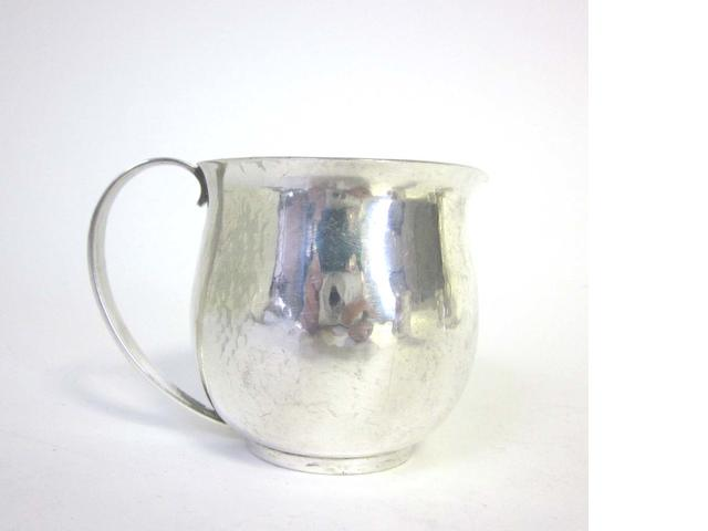A 20th century Danish silver  jug by Georg Jensen, Denmark Post 1945; together with an assortment of other items  (5)