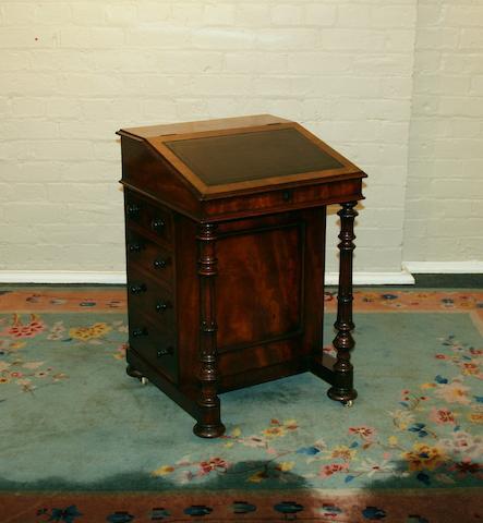 A mid Victorian mahogany Davenport