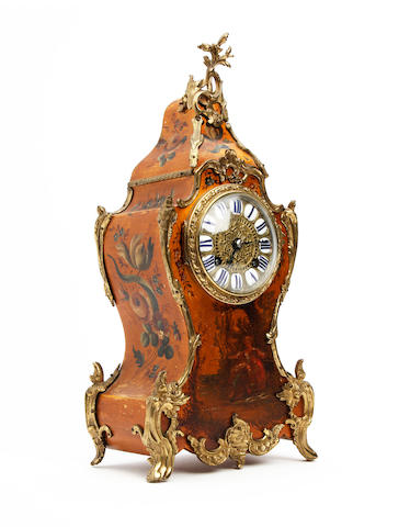 A 19th century French lacquered rococo style mantel clock with gilt metal mounts Japy Frere for A & N