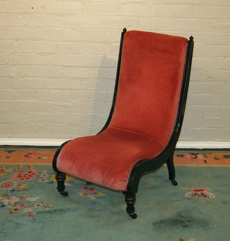A Victorian ebonised mahogany framed nursing chair