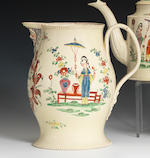 A fine creamware mask jug, dated 1773