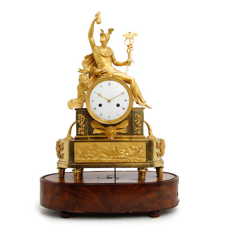 A rare early 19th century French Empire ormolu musical mantel clock Anonymous