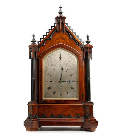 A fine and impressive Victorian Gothic revival figured walnut musical bracket clock with pull repeat. Anonymous