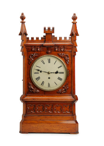 A Victorian Gothic oak triple-fusee musical bracket clock Anonymous