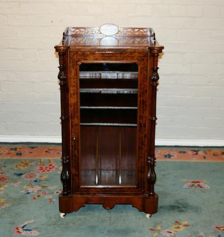 A Victorian burr walnut music cabinet