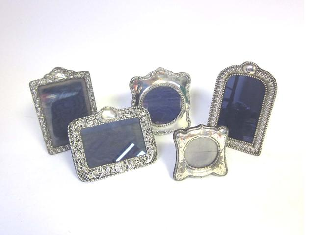 An Edwardian  silver photograph frame by H. Matthews, Birmingham 1906, together with seven other examples (8)