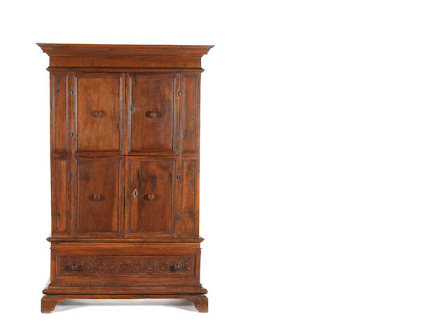 An Italian Baroque 17th century and later walnut armoire