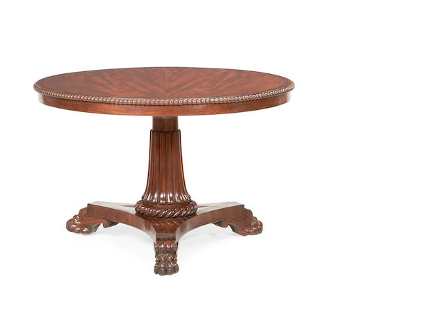 A Regency mahogany and ebonised inlaid breakfast table in the manner of George Bullock