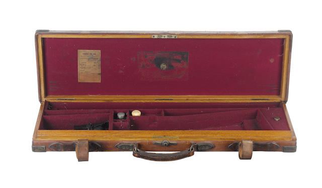 A James Purdey & Son brass-mounted oak and leather single-guncase
