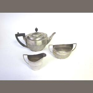 A  silver  matched three-piece tea service by William Hutton and Sons Ltd, London and Sheffield 1906; together with a matching hot water jug  (4)
