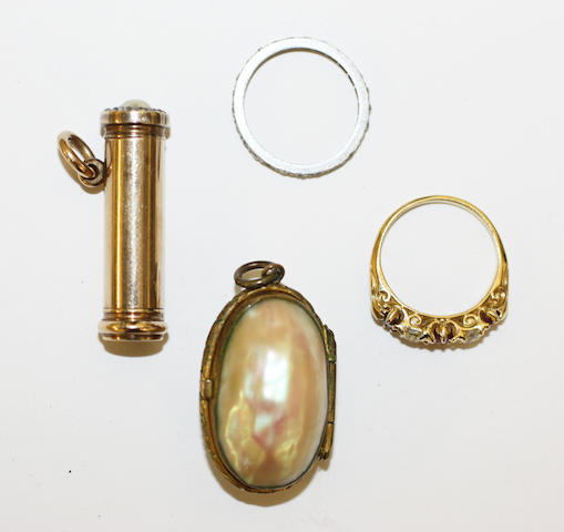 Two gem set rings a retractable pencil and a pendant,
