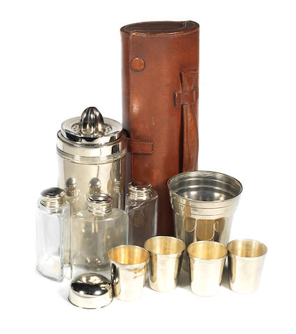 A leather-cased musical travelling cocktail set for four persons, retailed by Mappin & Webb, 1920s,