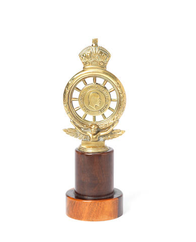King George V's Royal Automobile Club enamelled car badge by Elkington & Co, previously fitted to the Royal Daimlers,