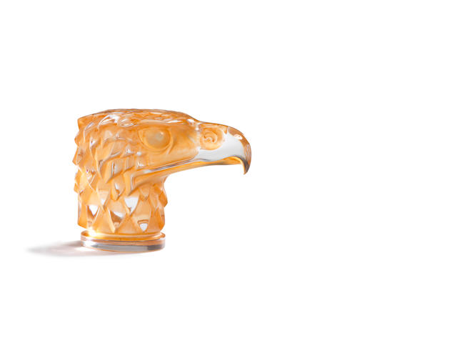 A pre-War 'Tete d'Aigle' glass mascot by René Lalique, introduced 14th March 1928,