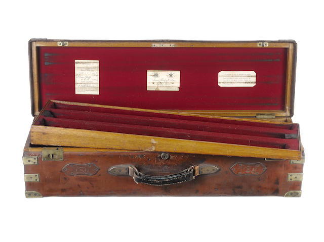 A James Purdey & Sons brass-mounted oak and leather triple-guncase