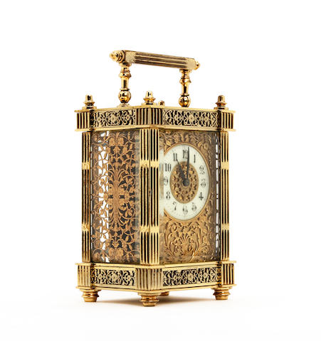 A small Gothic style late 19th century French gilt brass carriage clock  Anonymous