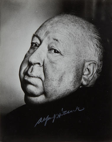 Alfred Hitchcock: A large autographed publicity photograph, together with original envelope,
