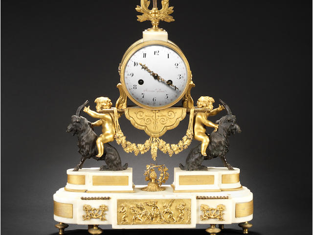 A good early 19th century French gilt and patinated bronze and marble mantel clock Mercier, Paris