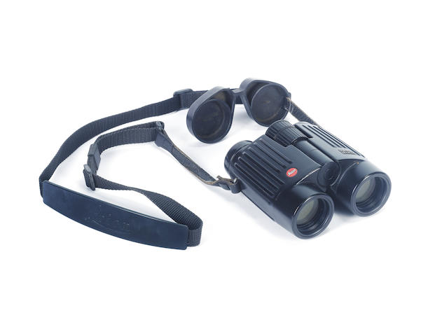 A pair of 8x32 BA binoculars by Leica Together with its nylon carrying-strap