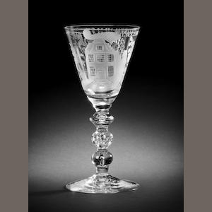 A Dutch-engraved baluster wine glass, circa 1730