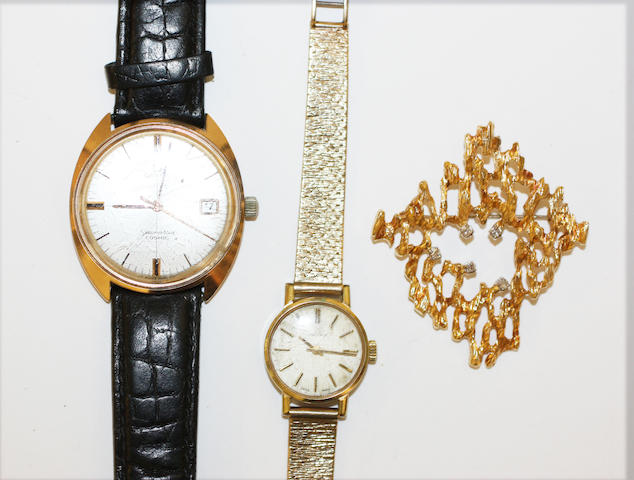 Two watches and a diamond set brooch,