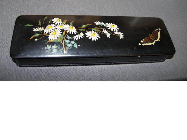 A Victorian papier mache box, the lid painted with daisies and a butterfly,