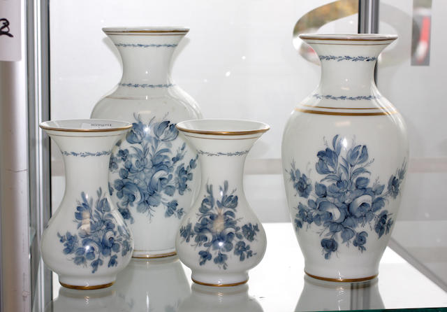 Two pairs of opaque glass vases painted with blue flowers