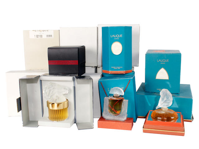 A group of various Lalique purfume bottles and powder jars