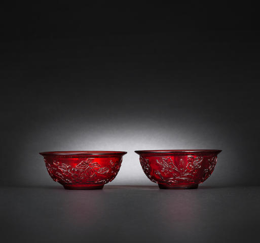 A pair of ruby red glass 'hibiscus and grapes' bowls Mid Qing dynasty