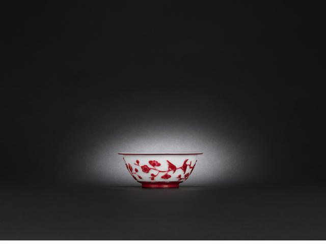 A red overlay glass 'magpies and prunus' bowl Mid Qing dynasty