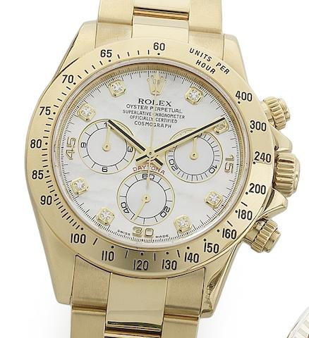 Rolex. An 18ct gold and diamond set automatic chronograph bracelet watch Daytona, Ref:116528, Serial No.Z858***, Circa 2006