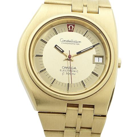 Omega. An 18ct gold electronic calendar watch together with fitted box and papers Megaquartz f24MHZ, Circa 1970