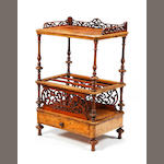 A mid-Victorian figured walnut Canterbury whatnot Bearing a paper label reading 'JOHN MANUEL & SON, Manufacturers, Devonshire Cabinet Works, Upholstery, Carpet, Brass and Iron Bedstead Warehouse, SHEFFIELD'