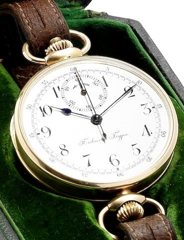 Paul Buhre. A very fine and rare early 20th century 18ct gold manual wind chronograph wristwatch together with original strap with gold mounts and buckle, fitted box printed with the Tsar Nicolas II insigniaCirca 1910