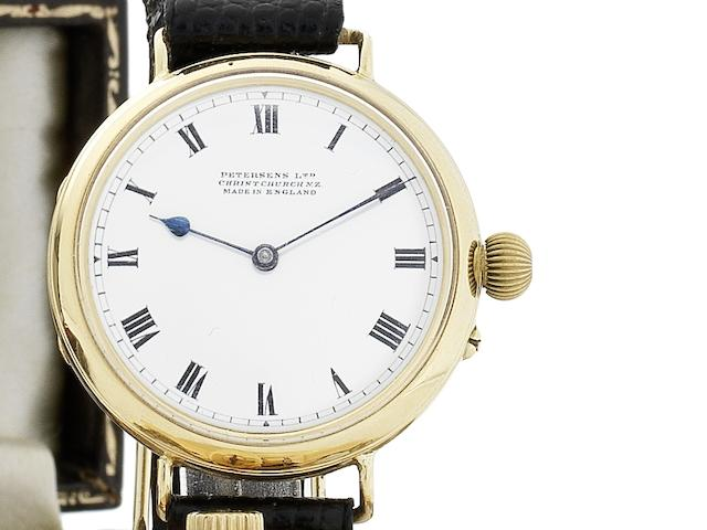 Petersens Ltd, New Zealand. An early 20th century gold wristwatch with enamel dial London Hallmark for 1910