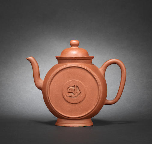 An Yixing stoneware 'roundel' teapot and cover, 17th/18th century