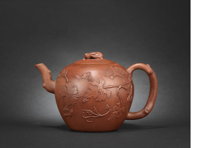 A large Yixing stoneware applique-decorated 'squirrel' teapot and cover, c.1700-25