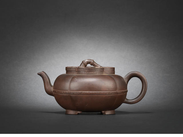 A melon-shaped Yixing stoneware teapot and cover, late 17th/early 18th century