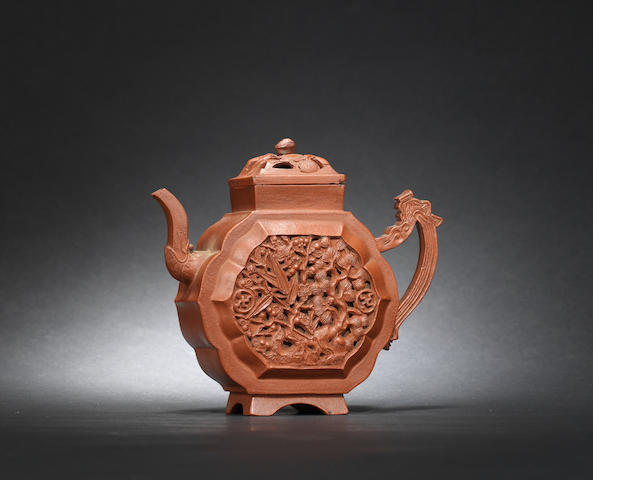 An Yixing reticulated 'prunus and pine' teapot and cover