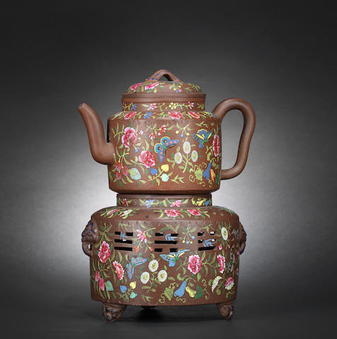 An Yixing enamelled teapot and cover with warming stand Mid Qing dynasty