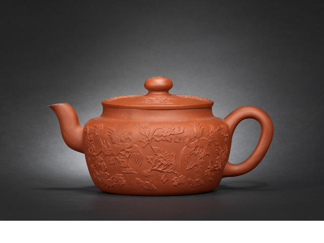 A large Yixing appliqué-decorated teapot and cover