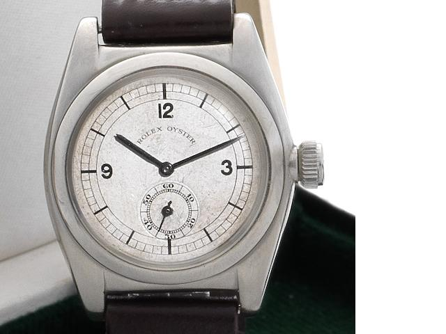 Rolex. A fine stainless steel automatic wristwatch made for the European market together with Rolex box Oyster Perpetual, Ref:1856, Case No.011442, Circa 1940